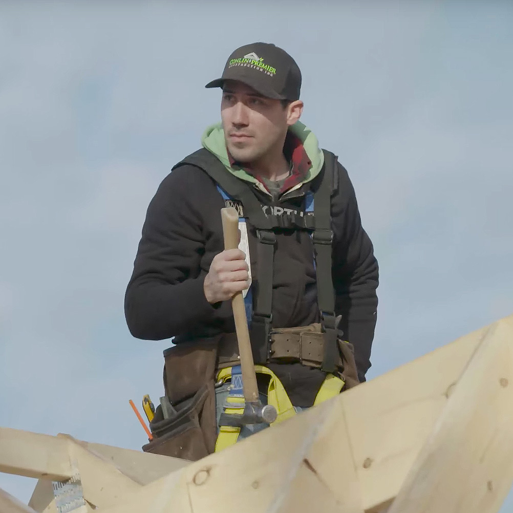 Jake Conlin doing carpentry on a rooftop