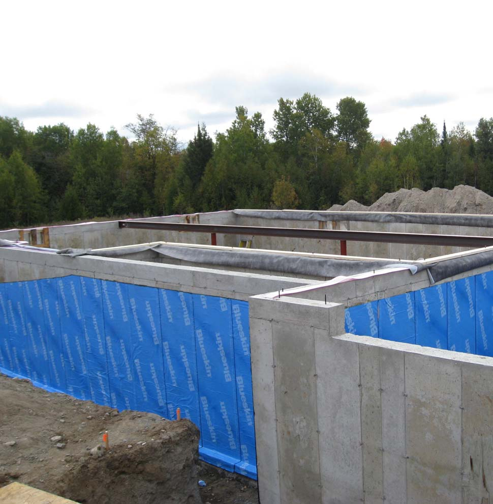 Custom home foundation wrapped with Blueskin